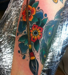 Paint brush and flowers tattoo