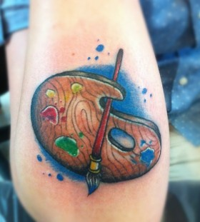 Paint brush and palette tattoo