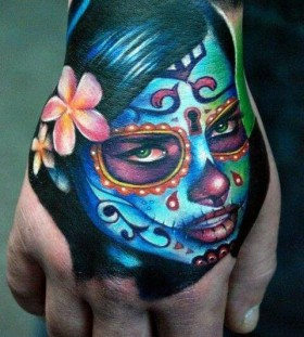 Painted face woman tattoo by Kyle Cotterman