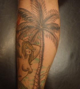 Palm tree and girl tattoo