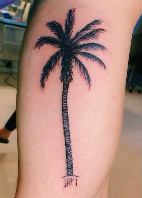 Palm tree leg tattoo