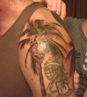 Palm tree with skulls tattoo
