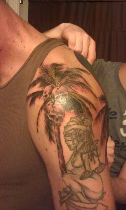 Palm tree with skulls tattoo