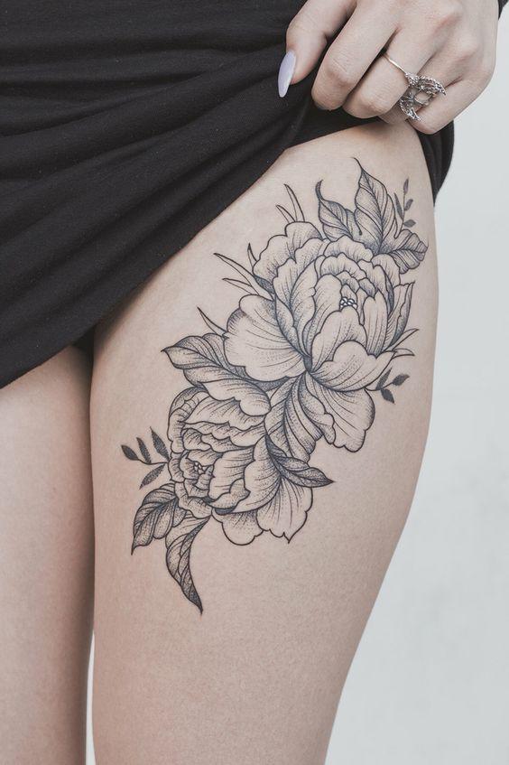 Peony flower on thigh tattoo
