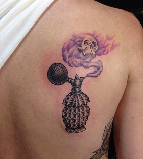 Perfume bottle and skull tattoo