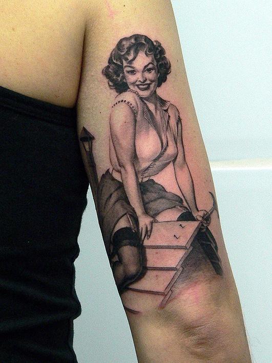 Pin up girl tattoo by Xavier Garcia Boix