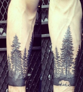 Pine trees and bear tattoo