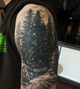 Pine trees arm tattoo