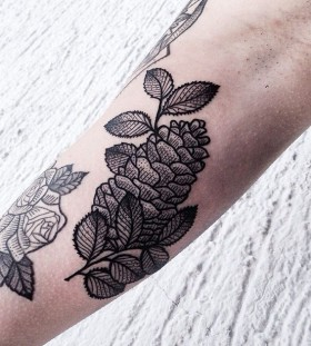 Pinecone tattoo on arm