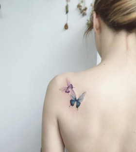pink-and-blue-butterfly-tattoos-by-tattooist_flower