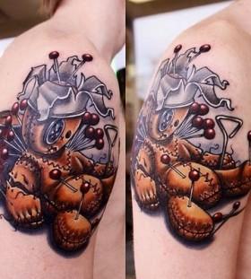 Pinned voodoo doll tattoo