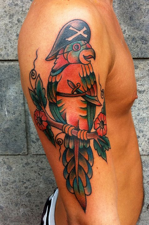 Pirate parrot on a branch tattoo