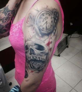 Pocket watch and skull tattoo