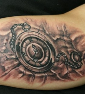 Pocket watch arm tattoo