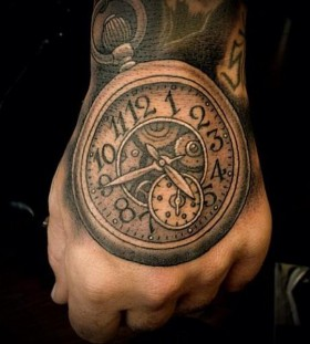 Pocket watch hand tattoo