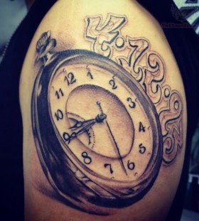 Pocket watch tattoo on arm