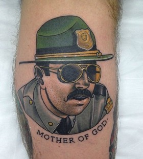 Police officer tattoo by Dan Molloy