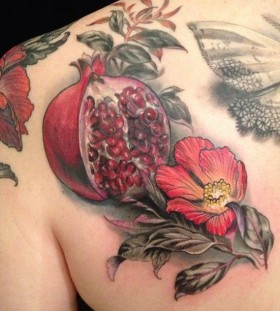Pomergranate back tattoo by Esther Garcia