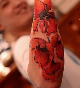 Poppies arm tattoo by Chen Jie