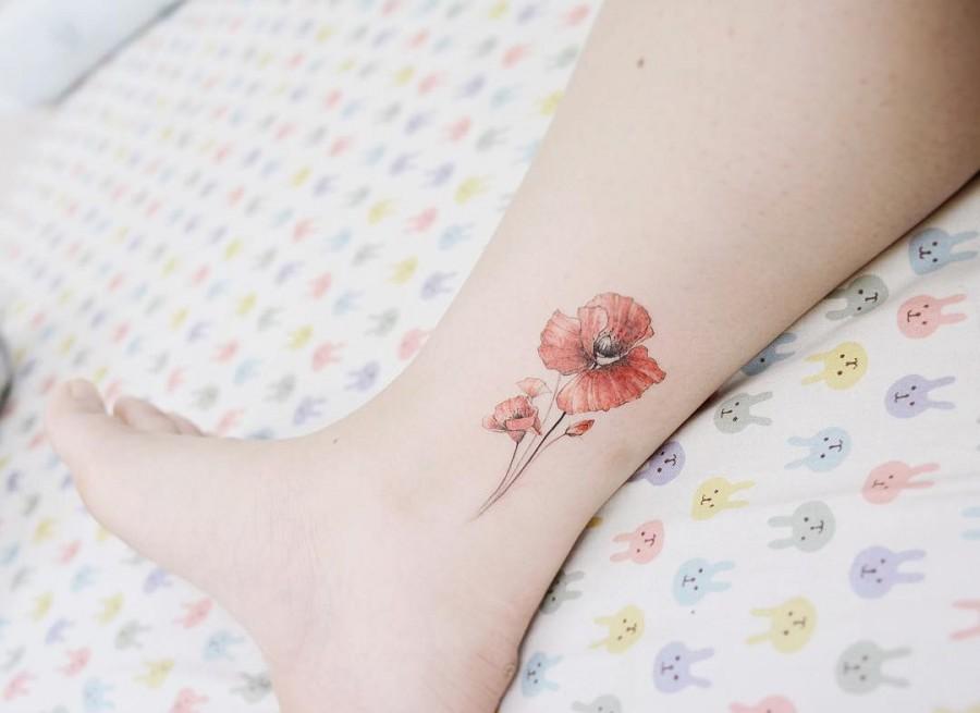 poppy tattoo by tattooist_banul