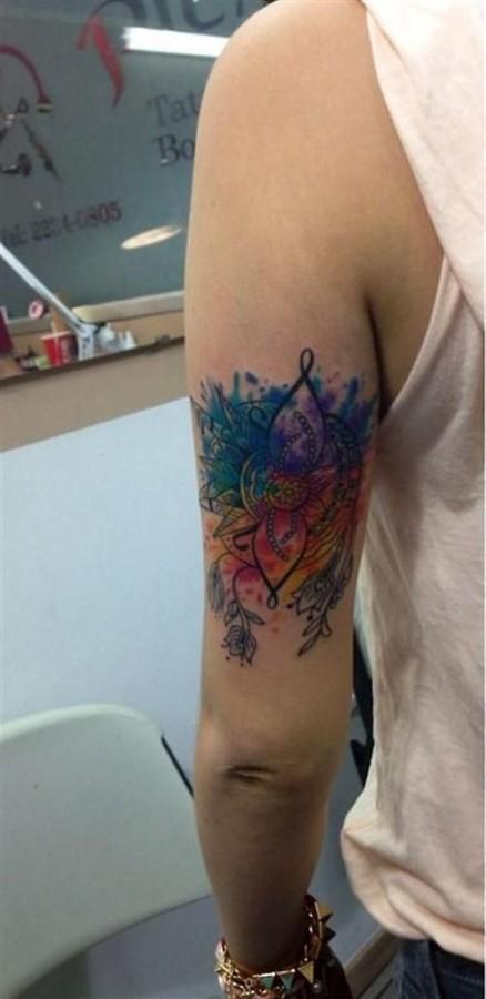 Pretty arms' watercolor tattoo