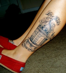 Pretty birdcage leg tattoo
