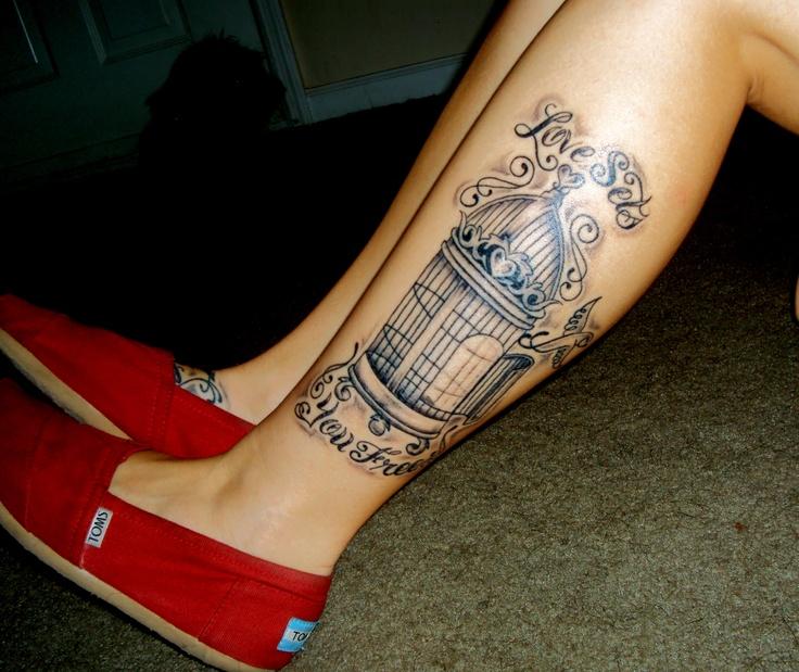 Pretty birdcage leg tattoo