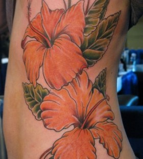 Pretty flowers side tattoo by Jon Mesa