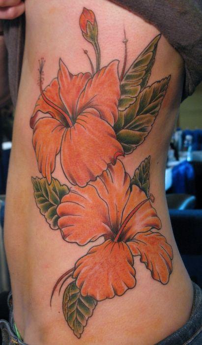 Pretty flowers side tattoo by Jon Mesa
