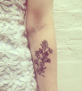 Pretty flowers tattoo by Rebecca Vincent