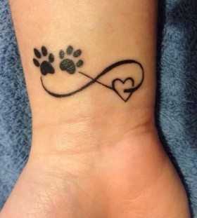 Pretty looking dog's palm tattoo