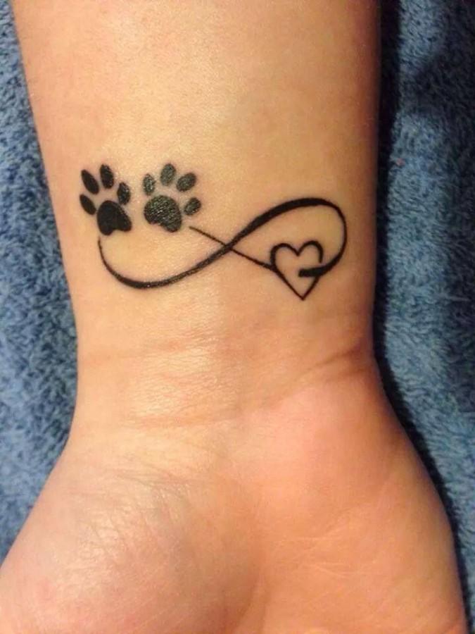 Pretty looking dog's palm tattoo