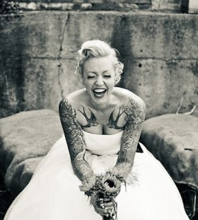 Pretty smiling bride tattoo