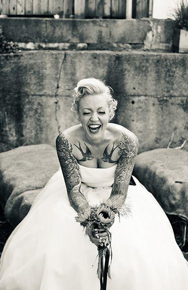 Pretty smiling bride tattoo
