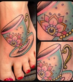 Pretty teacup foot tattoo