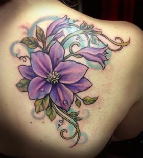 Purple flower back tattoo by Jessica Brennan