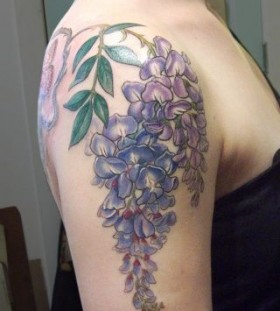 Purple flowers tattoo by Esther Garcia