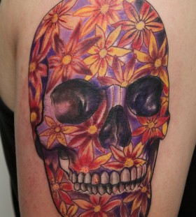 Purple skull and flowers tattoo