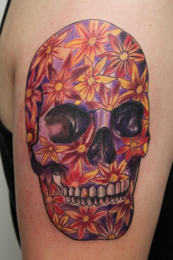 Purple skull and flowers tattoo