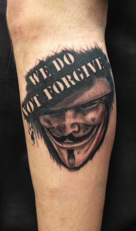 Quote and mask of V tattoo