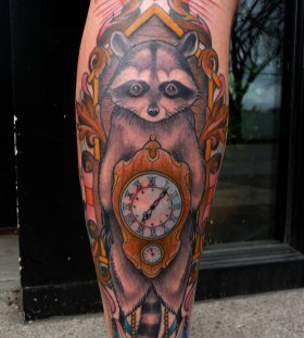 Raccoon and clock tattoo