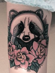 Raccoon and flowers tattoo