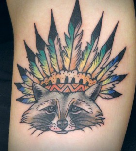 Raccoon wearing a feather hat tattoo
