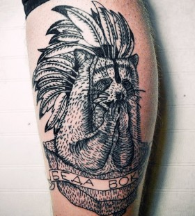 Raccoon with feather hat tattoo