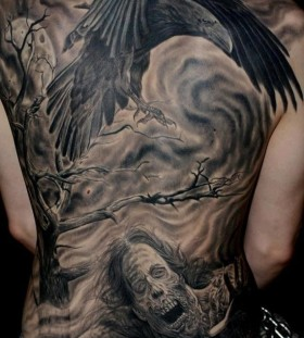 Raven and zombie back tattoo
