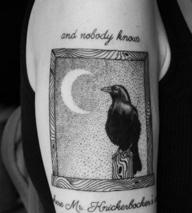 Raven frame and writing tattoo