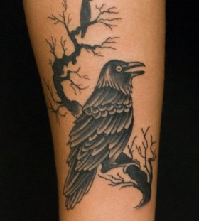 Raven on a branch tattoo