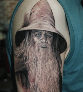 Realistic Gendalf arm tattoo