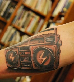 Realistic boombox arm tattoo