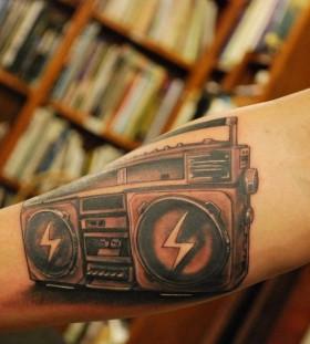 Realistic boombox arm tattoo